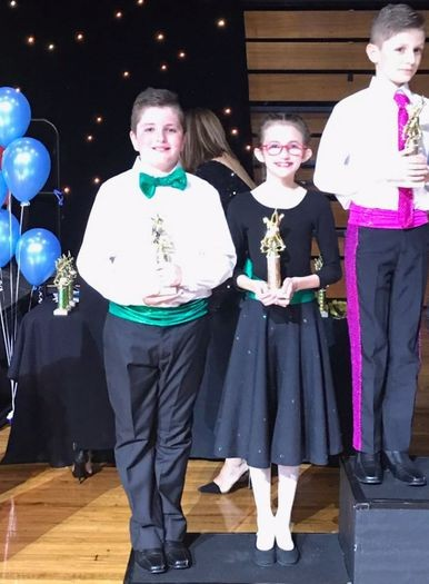 Students with awards at dancing